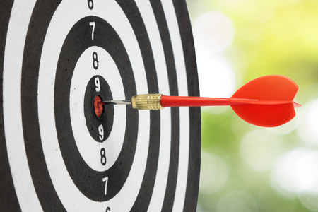 Target dart and arrow with abstract nature bokeh blur background. Stock Photo