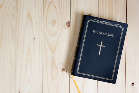 holy bible on wood table
