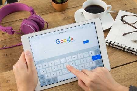 Google is an American multinational corporation specializing in Internet-related services and products. Most of its profits are derived from AdWords. Stock Photo - 96093254