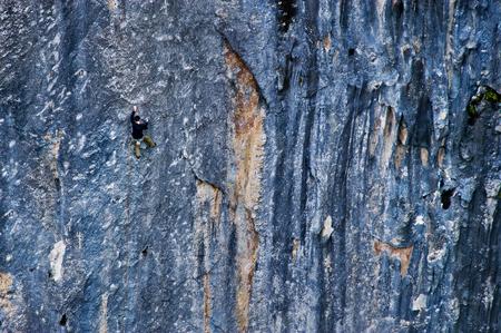 lead rope: Man climbing on the rock. Stock Photo