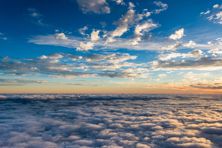 View of the beautiful sunset above the clouds.