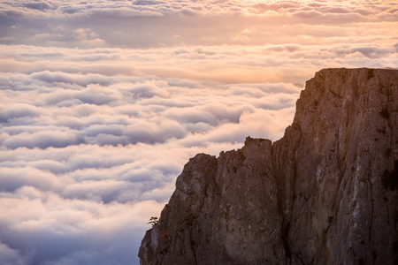 View of the beautiful sunset above the clouds in the mountains Zdjęcie Seryjne