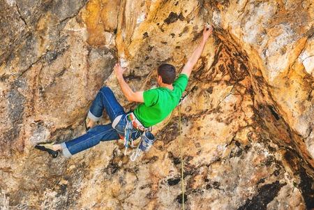 Rock climber climbs on the rock.