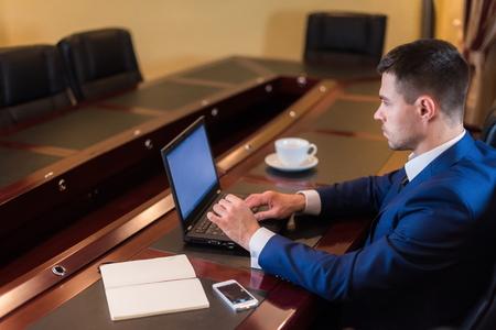 Business man in office with notebook. Zdjęcie Seryjne