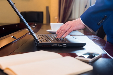 obsessed: Business man in office with notebook. Stock Photo