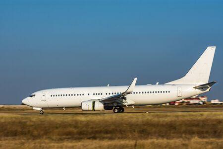 Airplane runs at high speed on runway.
