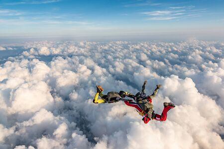 Group of skydivers above the clouds. Zdjęcie Seryjne