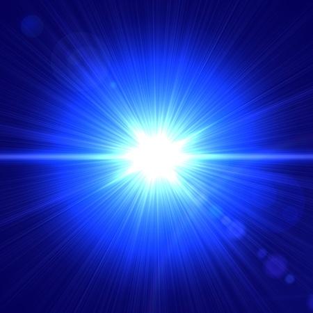 照らす: 青い背景の上に光の抽象的なレンズフレア 写真素材