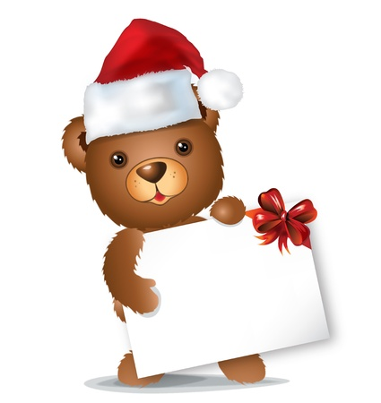 brown christmas bear with card and red hat standing photo