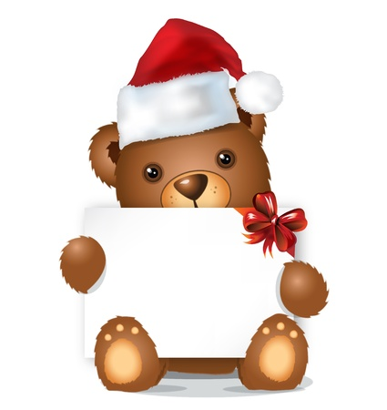 brown christmas bear with card and red hat sitting photo