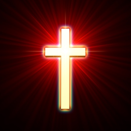 golden glowing cross over red light rays photo