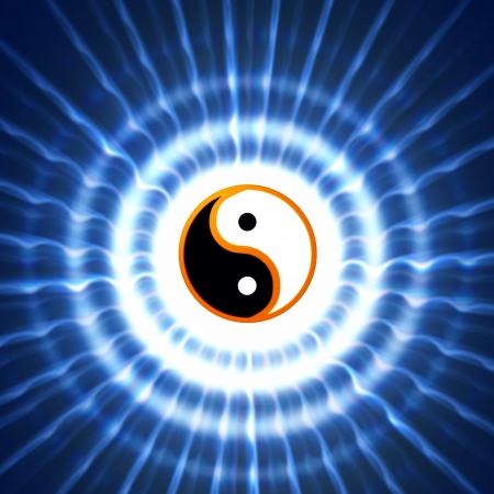 yin and yang symbol with blue rays photo