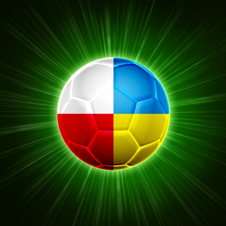football ball with polish and Ukrainian flag over green background photo