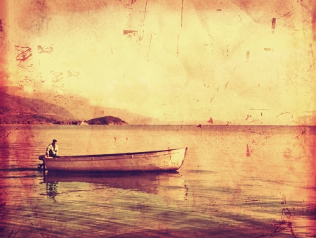 Lonely ferryman on boat vintage style photo