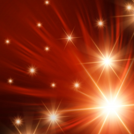 christmas background, abstract shining stars with orange rays lights photo