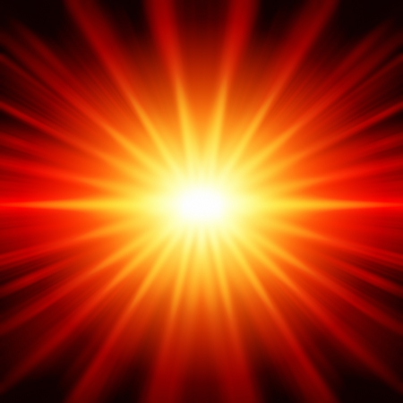 irradiate: abstract yellow and red rays lights like star over black background
