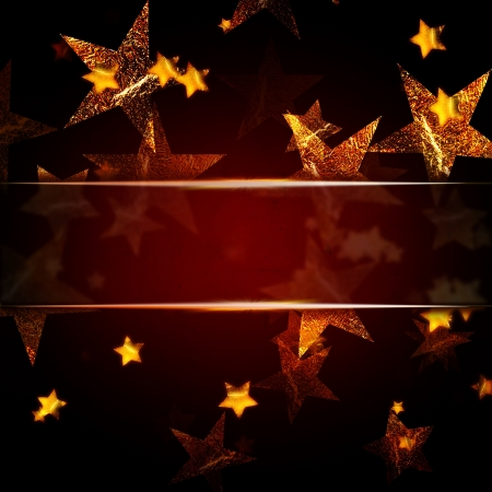 abstract golden stars over dark red christmas background with text space Standard-Bild