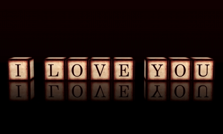 3d wooden cubes over black with letters makes text I love you, retro concept photo