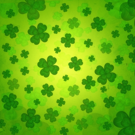saint patrick s day: shamrocks - vintage green background with striped four-leaved flowers over old paper Stock Photo