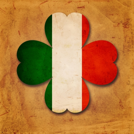 vintage Irish flag in shamrock over old paper background Stock Photo - 17777606