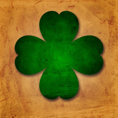 four leaved: shamrocks - vintage beige background with green four-leaved flower over old paper