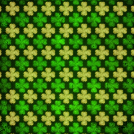 shamrocks - vintage green background with striped flowers over old paper out of focus Stock Photo - 17777630