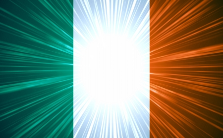 Irish flag with light rays abstract background photo