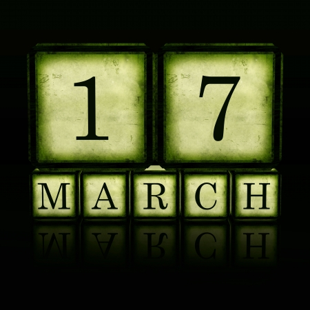 March 17 in 3d green wooden cubes with letters makes date, retro concept Stock Photo - 17777647