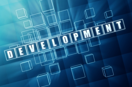 develop: development - text in 3d blue glass cubes with white letters, business concept