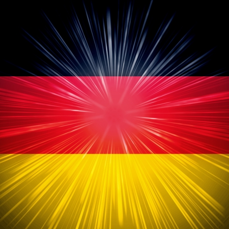 Abstract background German national flag with light rays photo