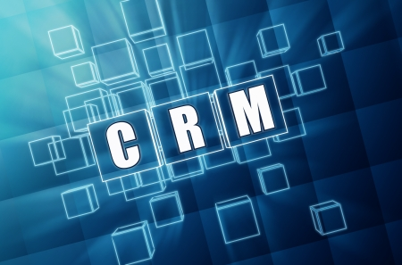 CRM - text in 3d blue glass cubes with white letters, business concept - customer relationship management photo