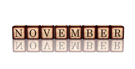 month november - text in 3d retro wooden cubes with letters and reflection, calendar concept element photo
