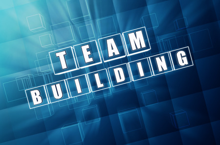 team building - text in 3d blue glass cubes with white letters, business teamwork concept words photo