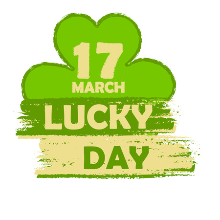 march 17: 17 March lucky day - text in green drawn banner with four leaved shamrock symbol, holiday seasonal concept