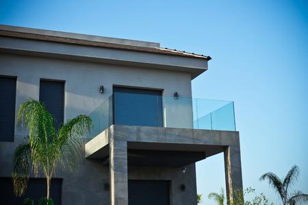 Grey modern house in minimalistic style with shut blinds 版權商用圖片 - 103686685