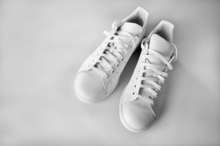 Pair of white sneakers on white background top view 写真素材