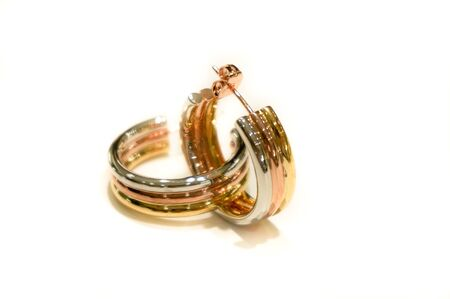 Pair of tricolor earrings on white background