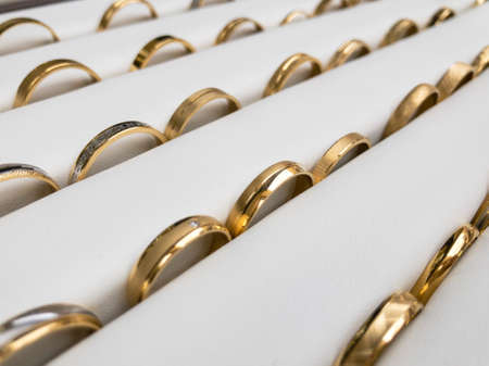 Gold wedding rings demonstration display white background