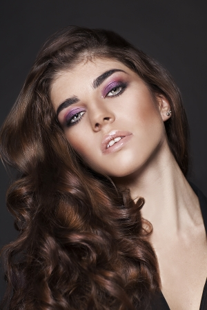 etalon: Portrait of young beautiful woman with curly brown hair  Fashion Beauty Girl   Stock Photo