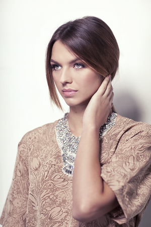 etalon: Beautiful high fashion model with necklace isolated on white background Stock Photo