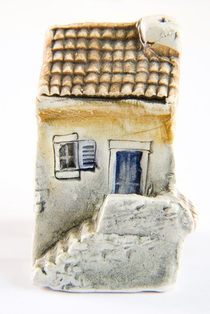 Small house souvenir for tourists on a white backgraund. photo