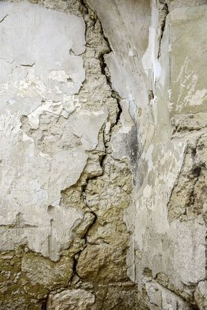 Big crack. A winding deep crack in an old stone wall. Close-up. Selective focus. Copy space. 스톡 콘텐츠