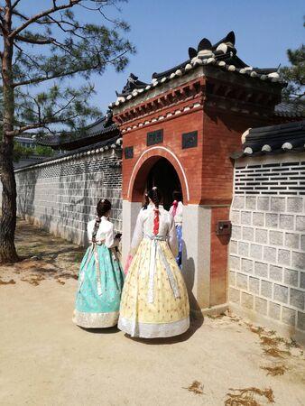 Beautiful girls dressed hanbok, Korean traditional dress, South Korea. Back view. Tourism, travel. Banco de Imagens