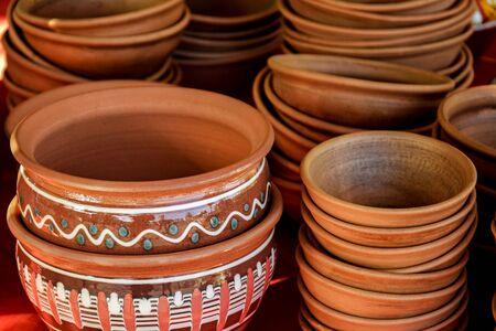 Trade of traditional ceramic bowls. Showcase of handmade ceramic pottery. Close-up. Selective focus.