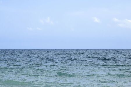 Waves at sea, horizon sky, wallpaper. Sea landscape background. White clouds in blue sky.