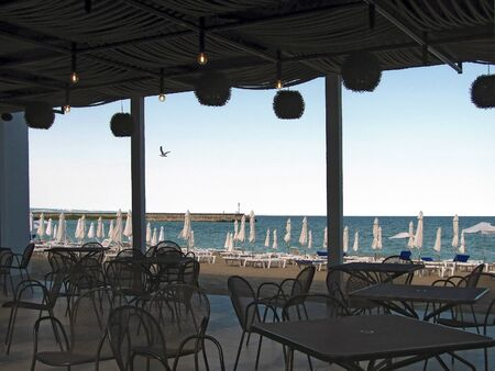 View of beach and sea pier from the coastal restaurant. Rest on black sea. Banco de Imagens