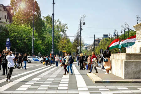 BUDAPEST, HUNGARY - MAY 2019: groups of tourists visit of famous Heroes Square, located in Pest.This square has been UNESCO World Heritage site since 2002.