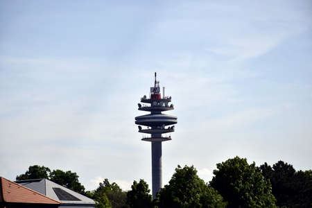 VIENNA, AUSTRIA - MAY 2019: Top of the Arsenalturm with logo of A1 Telekom against the blue sky. Also called funkturm wien arsenal, or Arsenal tower, is  telecommunications & transmission tower.