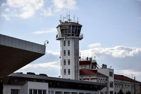Chisinau, Moldova - February 2020: Air control tower at the airport with blue sky and clouds on the background. Close-up. Selective focus. Copy space.