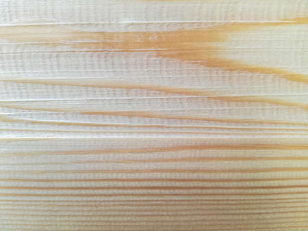 Planed pine board. Natural light wood texture. Close-up. Selective focus. Copy space.